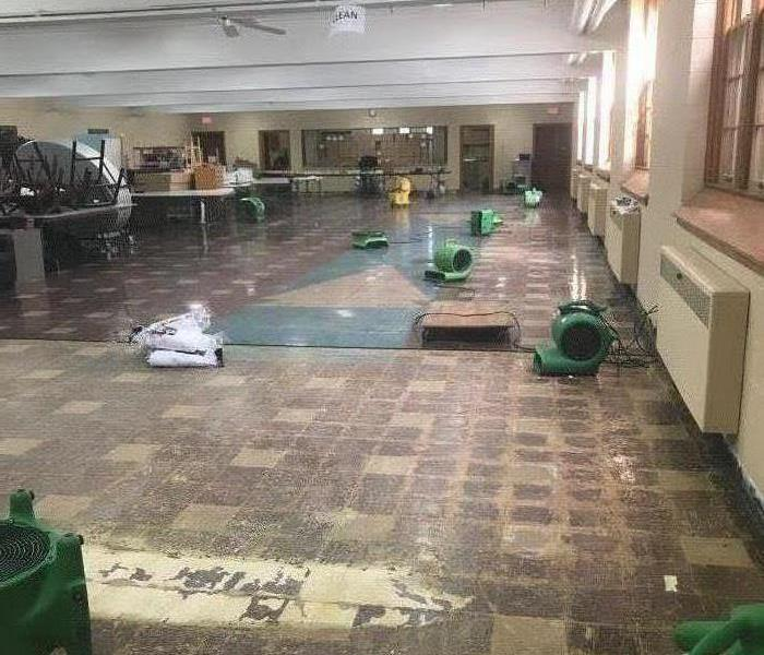 Flooded Interior Flooring After Storms with Fans Drying