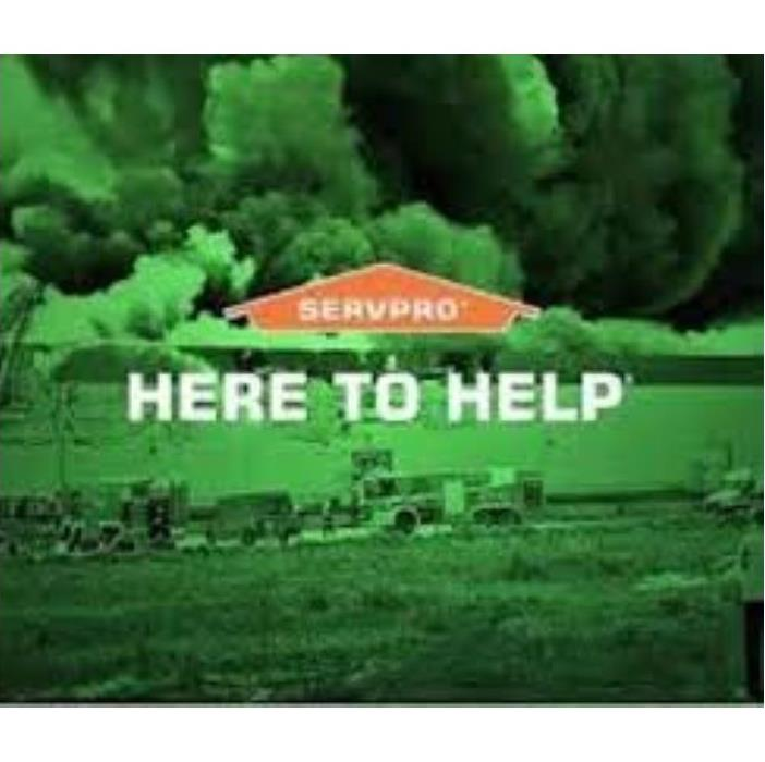 Green & Black Background of Disaster with SERVPRO logo & Words:Here to Help