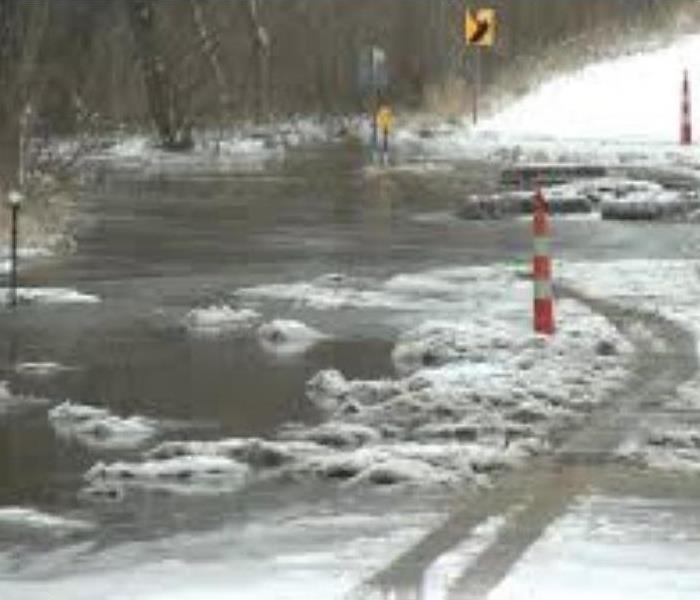 Melting Snow Along Roadside Caused Flooding