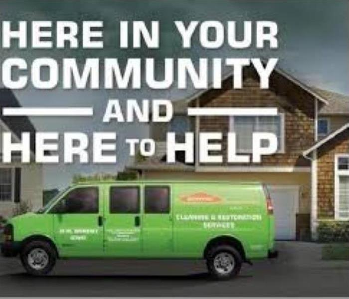 "SERVPRO van in front of residence ""here in your community & here to help"""