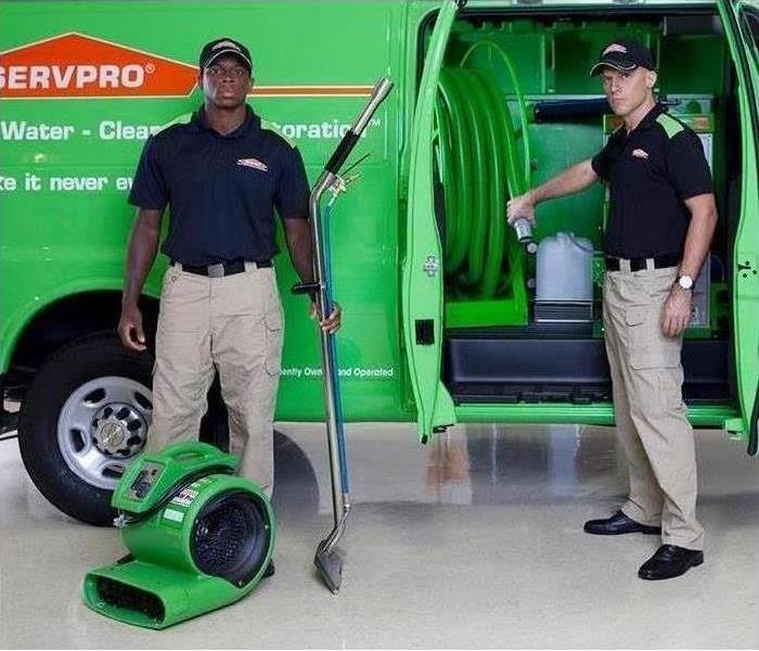 SERVPRO Specialists Standing Outside of Van with Equipment